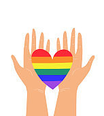 Vector illustration of two hands holding LGBTQ+ rainbow heart colors. Concept of pride, freedom, equality, rights, lesbian, gay, bisexual, transgender love and homosexuality. T-shirt print, emblem or logo
