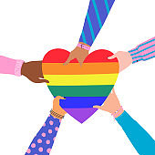 Vector illustration of cartoon flat Hands Holding Heart with rainbow colors. LGBTQ+  symbol of Love, Freedom, Peace, Lesbian. Gay Pride Community Month