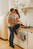 Lifestyle consept at home with couple young men and woman in kitchen