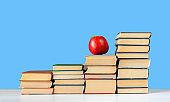 stack of hardback books. Education learning background
