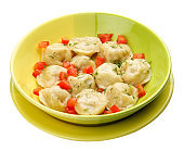 Dumplings with chicken on a bright plate. Meals for children.