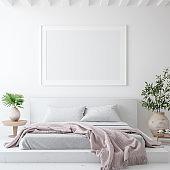 Mockup poster frame in white cozy bedroom interior, Scandinavian style