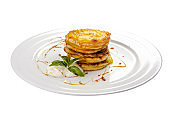 Pancakes with honey. Hungarian traditional dessert. On a white background