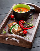 Cream-soup from tomatoes and baked pepper, with a multi-grain bread with smoked suluguni