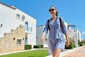 Summer vacation, beautiful teenager girl walking at resort sea spa hotel