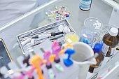 Close-up work at dentist desk, dental composite sealing materials instruments tools