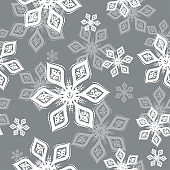 White and gray Snowflake seamless pattern on silver background