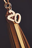 Gold graduation tassel with 2020 date charm