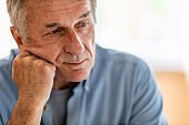 Portrait of senior man looking depressed