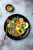 Grilled Halloumi cheese salad with quinoa, avocado, cucumber, toasted pine nuts dressed with honey balsamic vinaigrette. Healthy vegetarian dinner