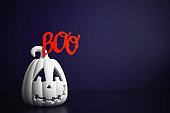 Halloween background with Jack O'lantern and BOO message