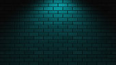 Green neon light on empty brick wall with copy space