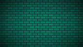 Empty brick wall with green neon light with copy space