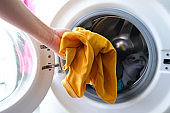 Woman's hand Pick up clothes Washing machine.Clean and Healthy Concepts