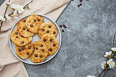 Chocolate chip cookies, top view. Dark background.