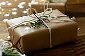 Christmas gift boxes wrapped with brown kraft paper over wooden background. Top view.