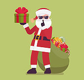 Secret Santa Claus with present box making hush, shh gesture