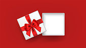 White open square gift box decorated with red ribbon tied bow on red background. Top view. Vector illustration.