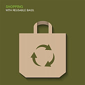 Shopping with reusable bags. Paper bag with recycle sign.