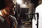 professional singer sing in recording studio