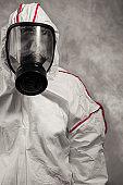 portrait of unrecognizable disinfector in protective suit