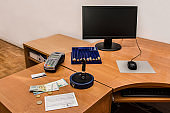 Post office. Postal stamp, bill, money, payment terminal and credit card on the desk