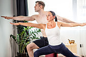 flexible active couple do exercises at home, workout