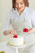 talented chef enjoys decorating cake