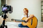 young blogger perform music at camera