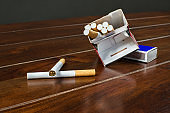 cigarettes and matches on a wooden table