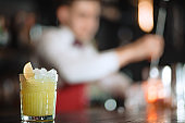 Alcohol cocktail in glass isolated on blurred restaurant background.