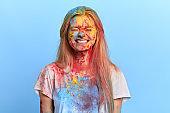 funny playful blonde girl enjoying holi festival