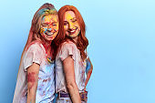 two friends take part in the smearing of colours