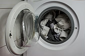 white clothes in an open washing machine