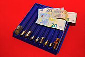 Euro money, coins, on red background