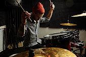 energetic professional drummer play on drums