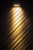Wooden wall background in a evening light.