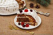 Sliced biscuit cake decorated with whipped cream and raspberries