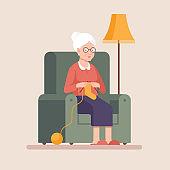 Senior woman knits.