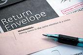 Closeup voter warning on envelopes