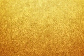 new year gold color glitter paper texture background or grunge canvas abstract