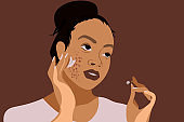 Close up portrait of black girl applying face cream for acne skin condition