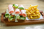 Rolled ham sandwich with fresh dill sauce
