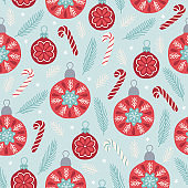 Christmas seamless pattern with balls, candy cane, fir branches, snow