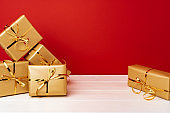 Christmas gift boxes against red background front view