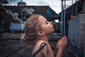 child girl praying in temple concept for hope and faith