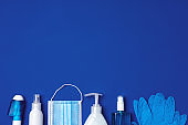 Row of antibacterial protective tools including face mask, gloves, soap and sanitizing gel