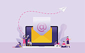 newsletter and marketing email concept vector illustration, people accept newsletter or marketing email in their devices, laptop with big envelope as email in their inbox