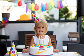 Adorable happy child, little kid boy celebrating his birthday