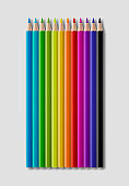 Set of color wooden pencil collection on grey background